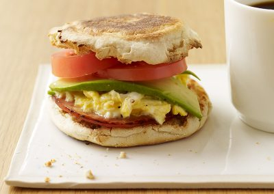 Egg and Canadian bacon sandwiches with avocado and tomato